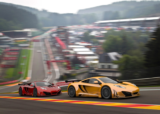 Yellow and Red Racecars Driving fast on Racing Track